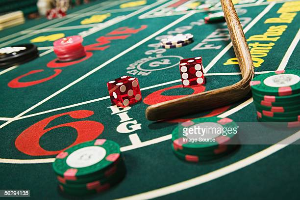 Croupier stick clearing craps table