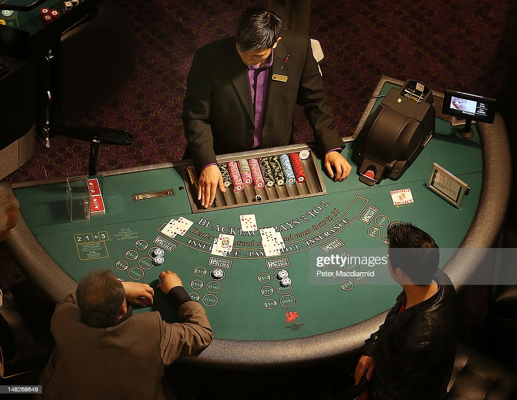 A croupier works at a blackjack table at The Hippodrome Casino near Leicester Square on July 13, 2012 in London, England. The new casino has five floors and 90,000 square feet of slot machines, blackjack and roulette tables.