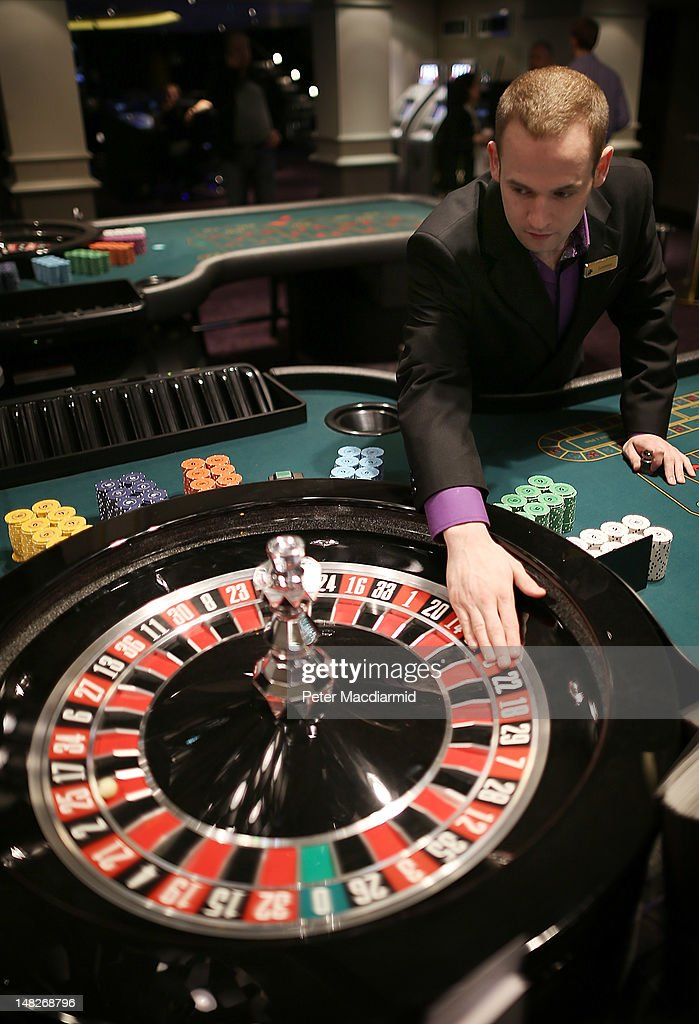 A croupier works at a roulette table at The Hippodrome Casino near Leicester Square on July 13, 2012 in London, England. The new casino has five floors and 90,000 square feet of slot machines, blackjack and roulette tables.