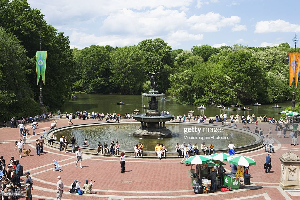 Crowd around Angel of the Waters Fountain at Bethesda Terrace, Central Park, New York City, NY, USA : Stock Photo