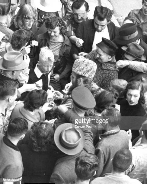 Crowd Around FurHatted White Buys Silver Dollars At 50 Cents Each It took awhile before anyone would believe he was not fooling Credit Denver Post