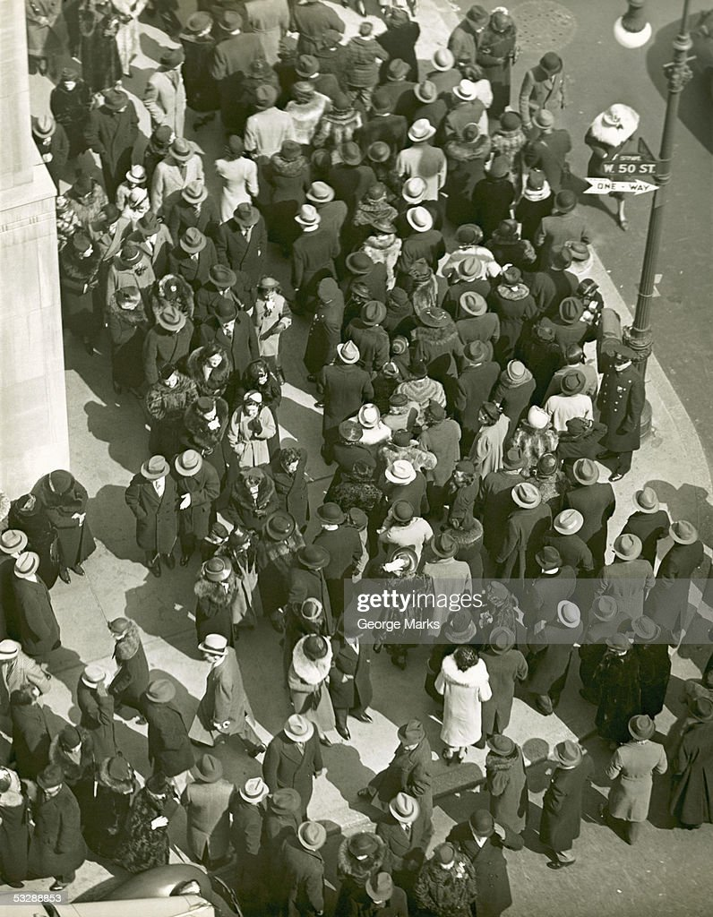 Crowd at busy street corner : Stock Photo