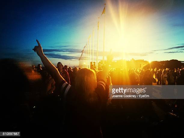 Crowd at concert during sunset