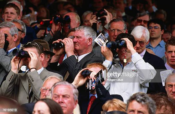 Crowd at races using binoculars, Galway Horse Races.