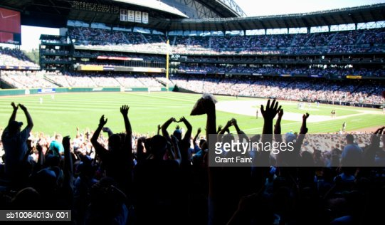 Crowd at stadium cheering during baseball match