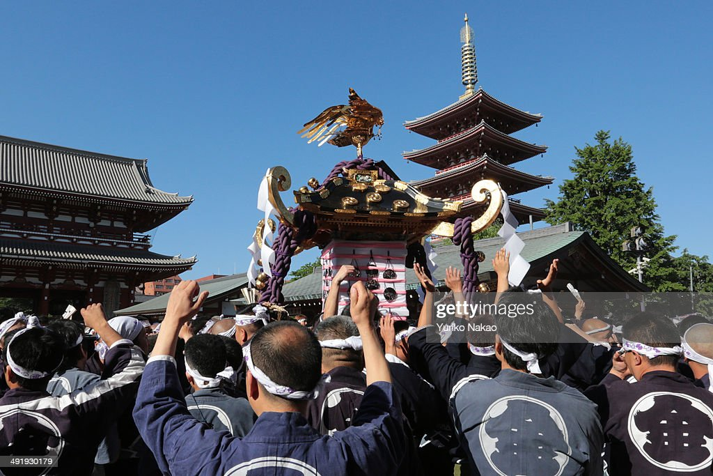 A crowd carries one of the three Asakusa Shrineowned portable shrine or mikoshi in front of the Sensojitemple during the Sanja Festival on May 18...