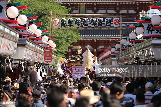 A crowd carries one of the three Asakusa Shrineowned sacred portable shrine or mikoshi in front of Sensojitemple after it left Asakusa shrine during...