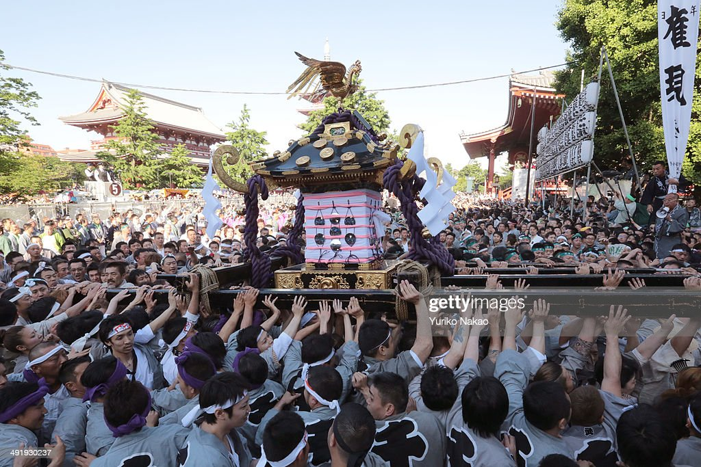 Crowd carry one of the three Asakusa Shrineowned sacred portable shrine or mikoshi at Asakusa shrine during 'Miyadashi' a ritual to carry out the...