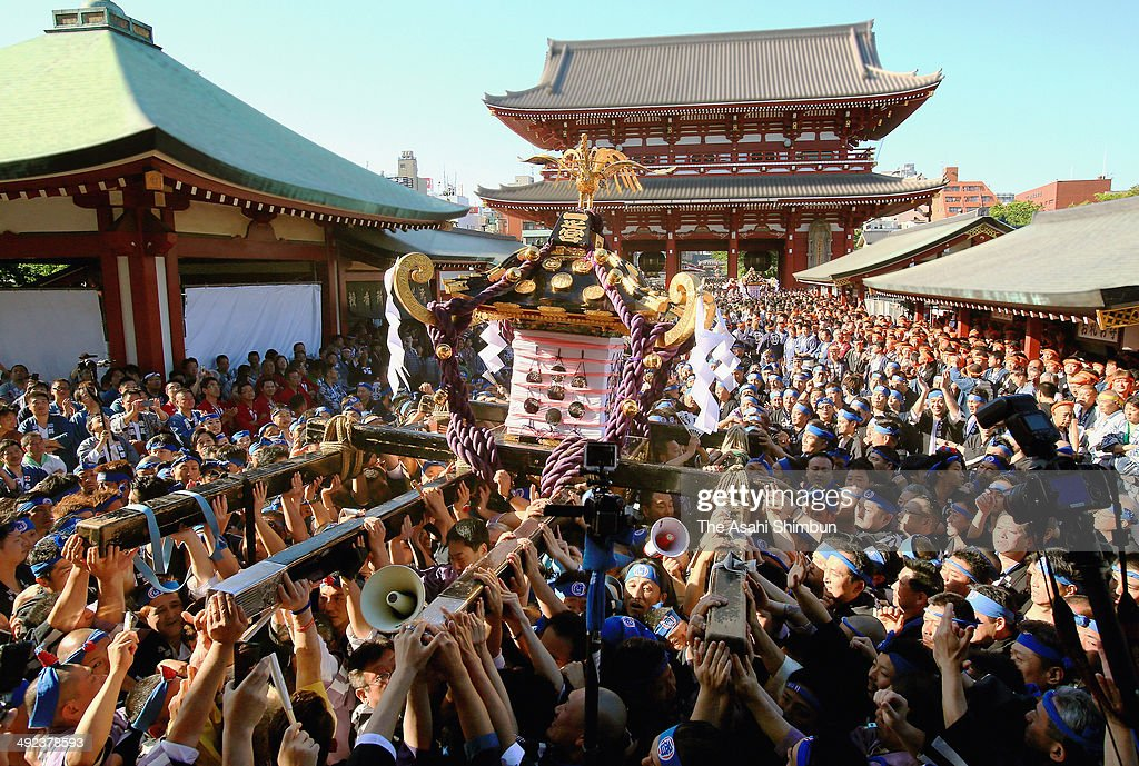 Crowd carry one of the three Asakusa Shrineowned sacred portable shrine or mikoshi during 'Miyadashi' a ritual to carry out the portable shrines from...