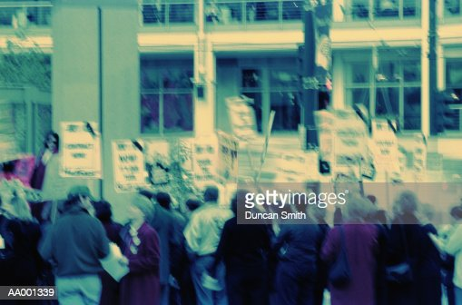 Crowd Carrying Protest Signs