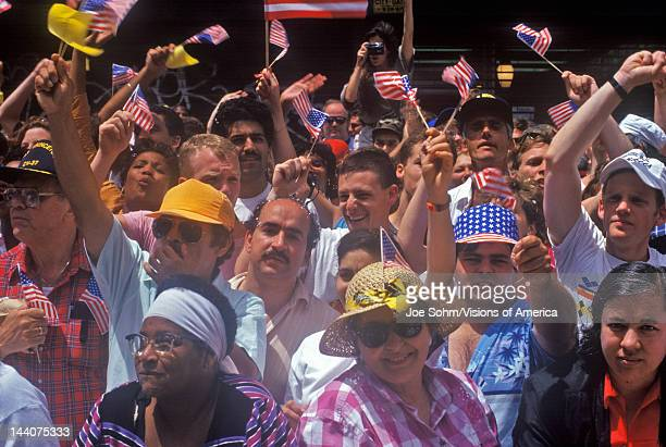 Crowd celebrating after Desert Storm at tickertape parade New York NY