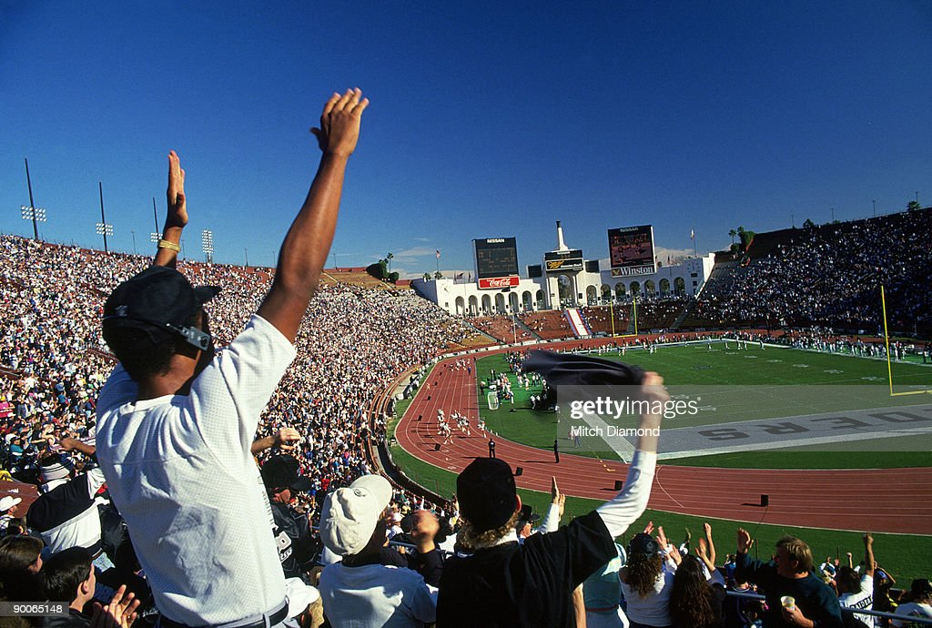Crowd cheering at track meet. : Stock Photo