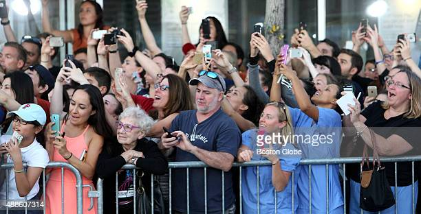 Crowd cheers as actors arrive at the premier of the movie Black Mass at the Coolidge Corner Theater in Brookline Mass Sept 15 2015