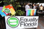 A crowd cheers during a celebration party in Orlando Fla on Thursday July 17 2014 The party hosted by Equality Florida was in celebration of a...