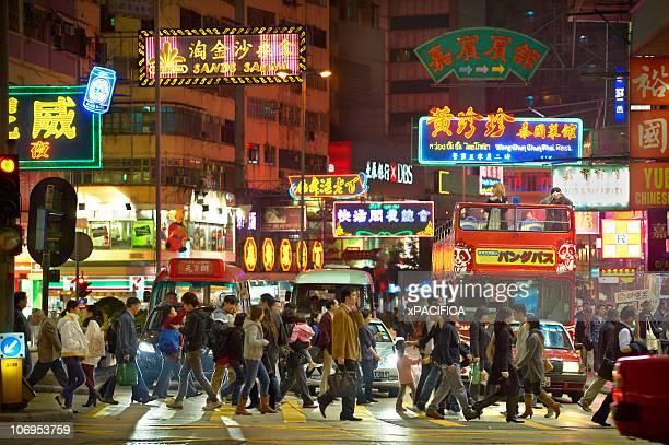 Crowd crossing busy street