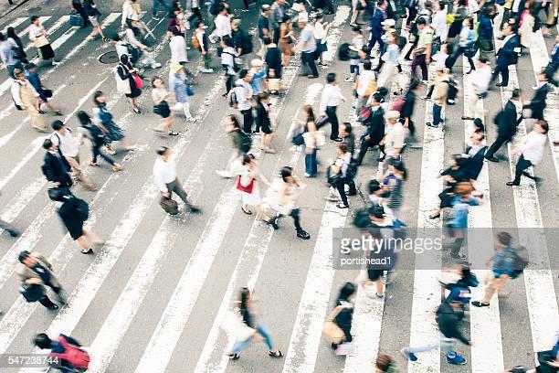 Crowd crossing the street on walkway in Kyoto, Japan