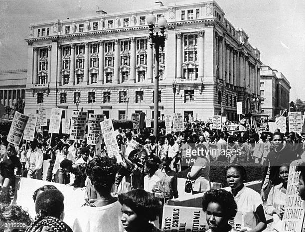 A crowd demonstrating on the twenty fifth anniversary of the Brown vs Board of Education ruling which declared that segregation in public schools was...
