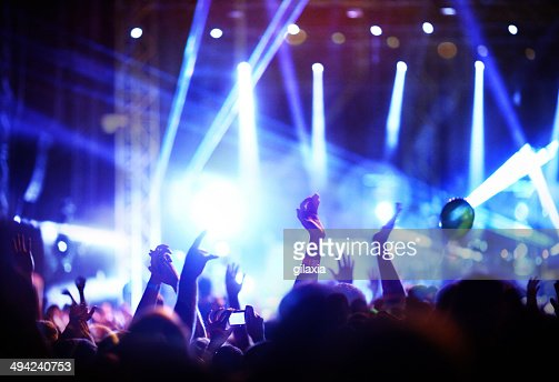 Crowd enjoying a concert.