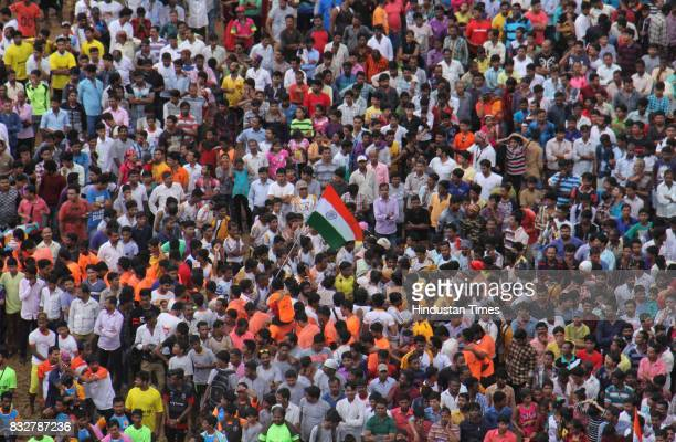 Crowd gather to see Govinda Mandals during Dahi Handi celebration on the occasion of Janmashtami at Borivali on August 15 2017 in Mumbai India The...