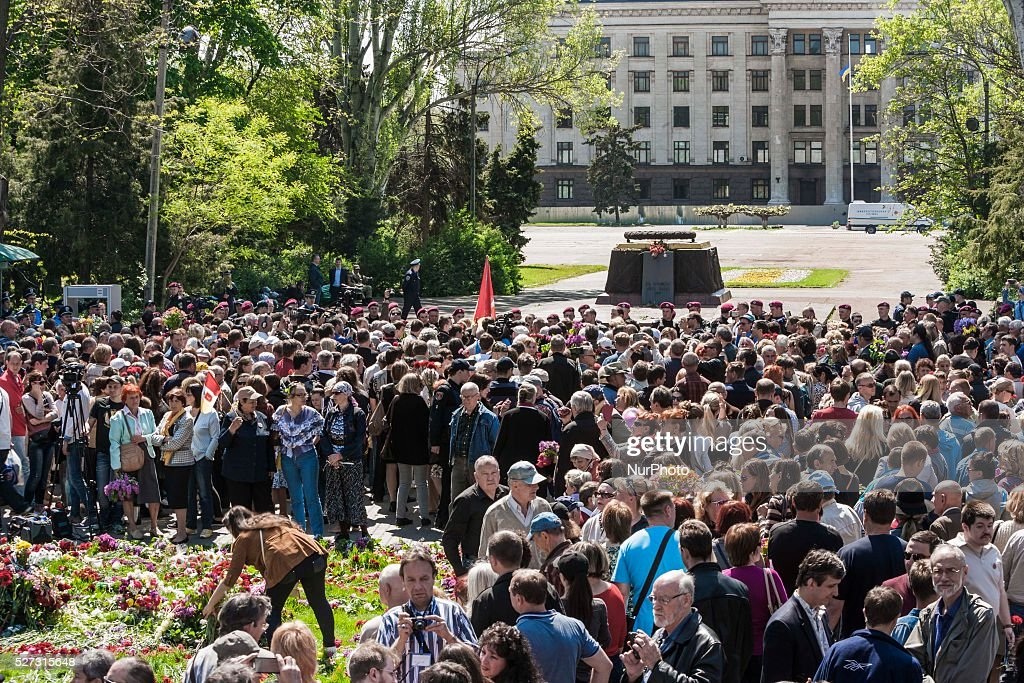 Crowd gathered in the main entrance to Kulikovo Pole square in Odessa, southern Ukraine, on May 2, 2016, during the remembrance of the dead people in the Trade Unions House clashes on 2nd of May on 2014. The square was closed all the day by strong police security because a bomb threat.