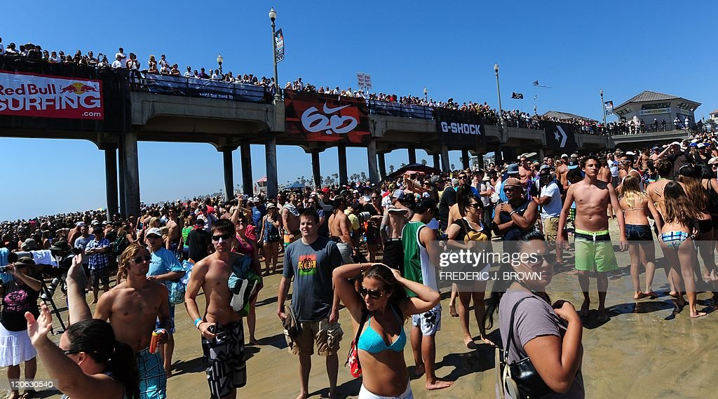 A crowd gathered on Huntington Beach and the pier to watch as Kelly Slater of the US won the final of the US Open of Surfing on August 7 2011 in...