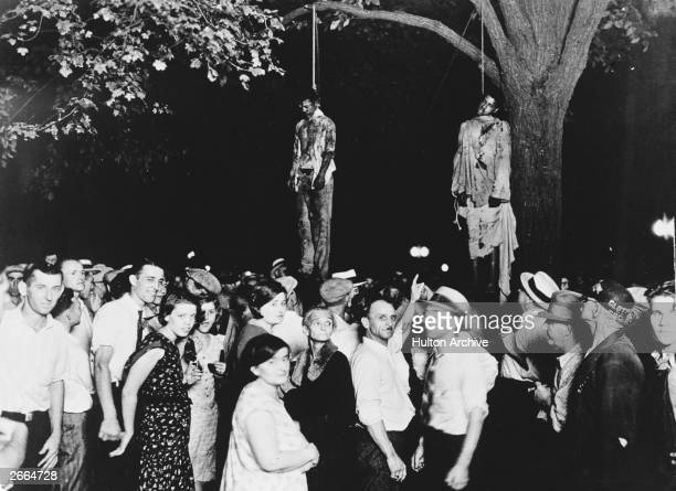 A crowd gathering to witness the killing of Thomas Shipp and Abram Smith two victims of lynch law in Marion Indiana 7th August 1930 This image was...