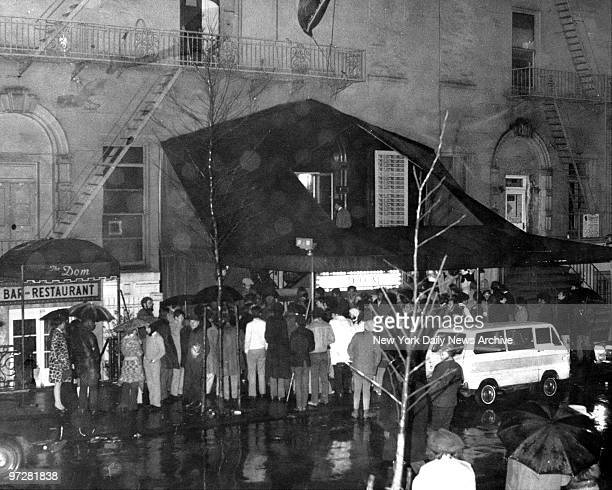 Crowd gathers around steps leading to the Electric Circus 23 St Marks Place between 2nd and 3rd Avenues New York City shortly after explosion in the...