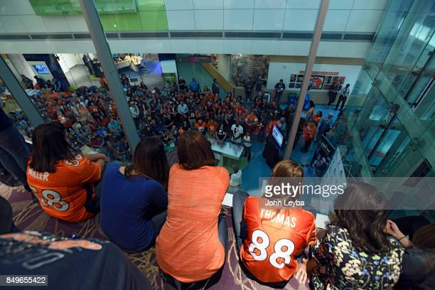 A crowd gathers as they watch Denver Broncos Aqib Talib and Jamaal Charles compete with Childrens Hospital Colorado employees on September 19 2017 in...
