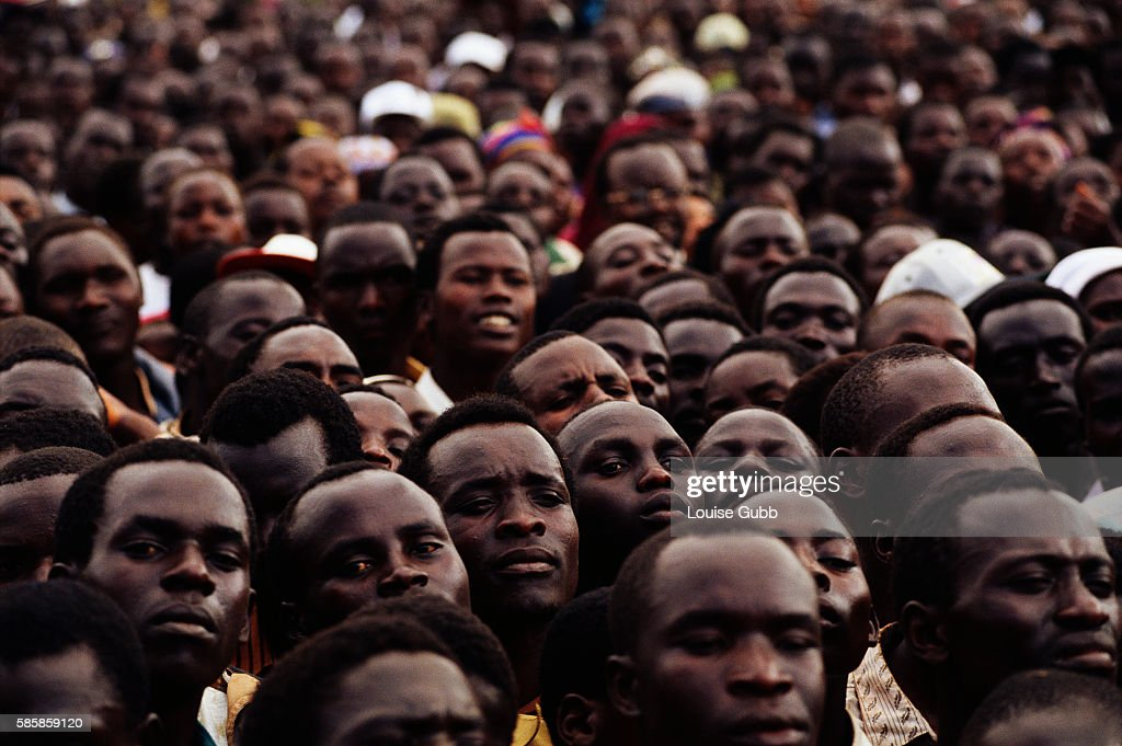 A crowd gathers at the town hall in Kapchorwa Uganda to listen to President Yoweri Museveni speak out against female circumcision While a traditional...