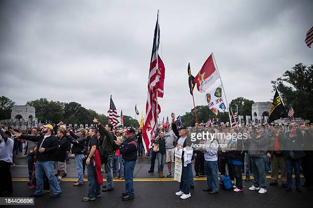 A crowd gathers at the World War Two Memorial to support a rally centered around reopening national memorials closed by the government shutdown...