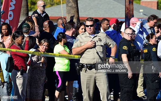 A crowd gathers behind police line near the scene of a shooting on December 2 2015 in San Bernardino California One or more gunman opened fire inside...