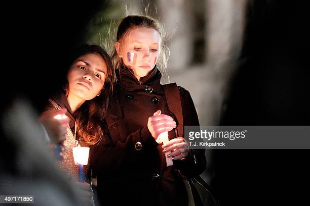 A crowd gathers for a vigil in honor of the victims of terrorist attacks in Paris at Lafayette Square outside the White House on November 14 2015 in...