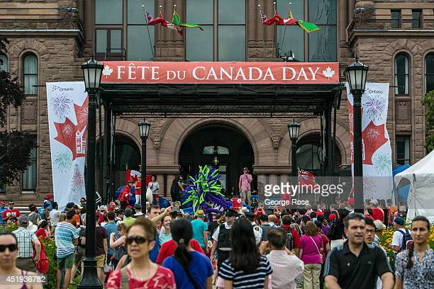 A crowd gathers for the Canada Day celebration on the lawn of the Legislative Building at Queen's Park on July 1 2014 in Toronto Ontario Canada...