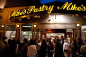 Crowd gathers in front of famous 'Mikes Pastry' bakery on Hanover Street Italian district of Boston MA