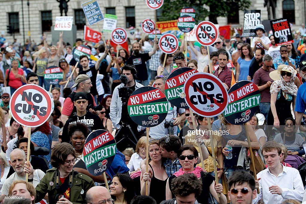 A crowd gathers in Parliament Square to protest against the government's austerity cuts on June 21, 2014 in London, England. The crowd of thousands marched from Oxford Circus to Westminster where they listened to speakers including Russell Brand and Diane Abbott MP.