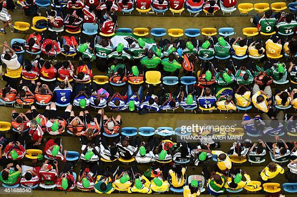 Crowd gathers in their seats ahead of the quarterfinal football match between France and Germany at The Maracana Stadium in Rio de Janeiro on July...