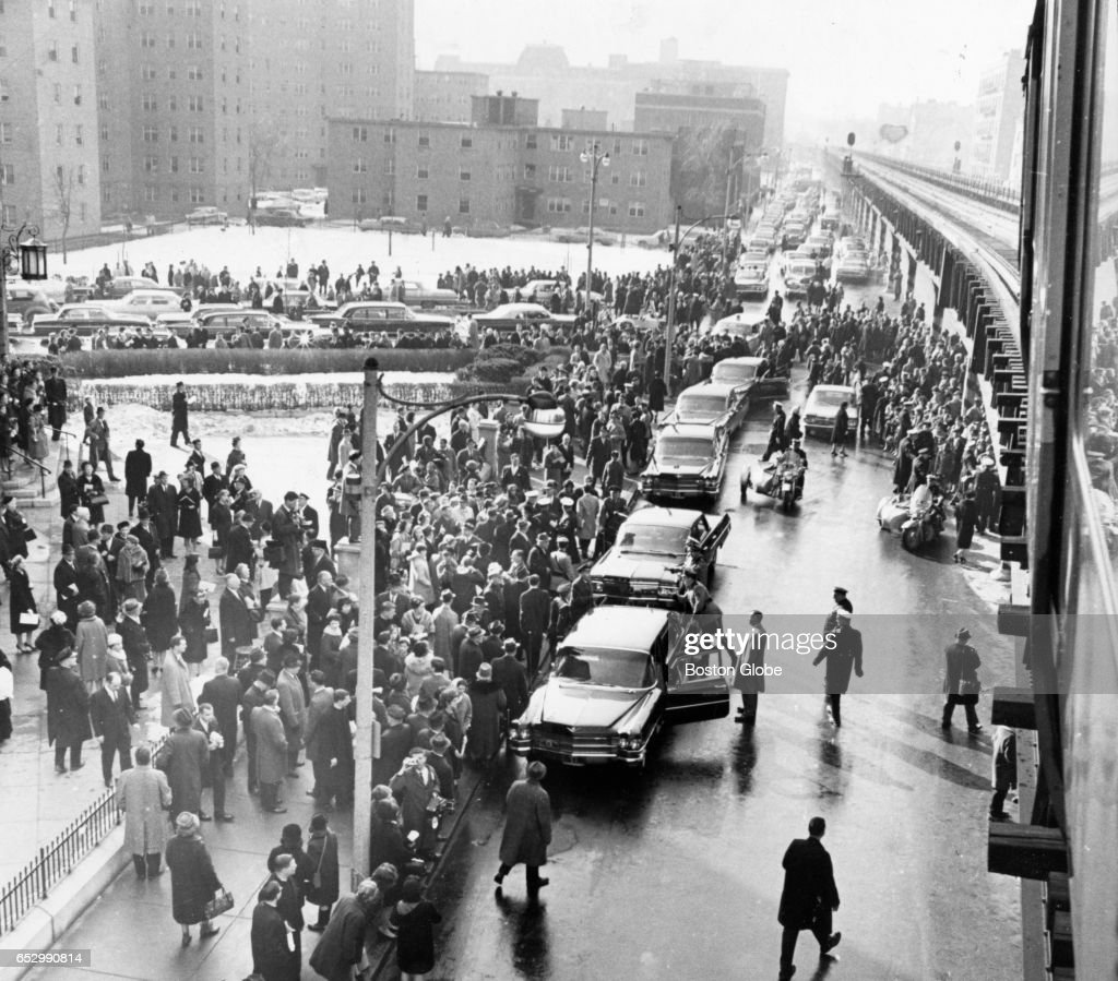 A crowd gathers outside Holy Cross Cathedral in Boston on Jan. 19, 1964, for a mass for John F. Kennedy. Kennedy was killed on Nov. 22, 1963.