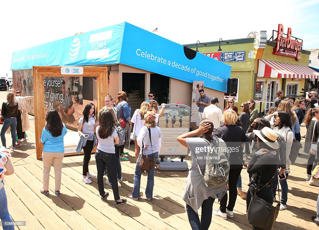 A crowd gathers outside the AT&T and TOMS 10 Year Celebration Shoebox at Santa Monica Pier on May 6, 2016 in Santa Monica, California.