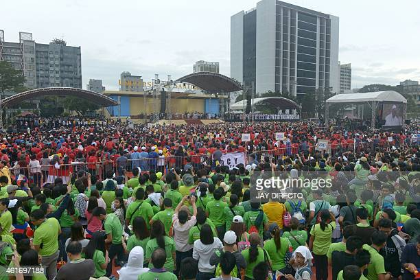 A crowd gathers to see Pope Francis during his visit to the University of Santo Tomas in Manila on January 18 2015 Pope Francis will celebrate mass...