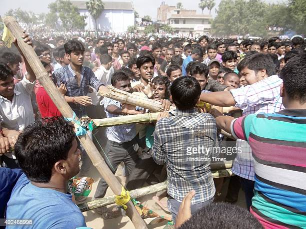 Crowd getting angry over late arrival of Bollywood actor Ajay Devgn at an election rally for the ongoing Bihar Assembly Elections on October 13 2015...