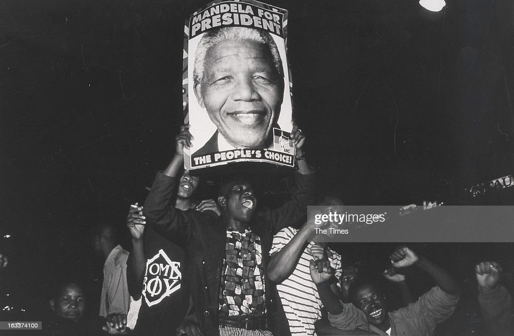 A crowd holding a poster with 'Mandela for President' written on it on May 2, 1994 in South Africa.
