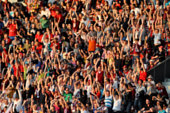 Crowd in a stadium. Blurred heads and faces of spectators