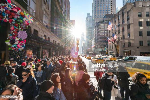Crowd in front of Saks Fifth Avenue window displays, who watches the Christmas decoration of winter holiday 2016. Many tourist and shoppers make congestion around midtown on Fifth Avenue New York.