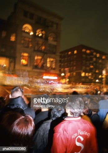 Crowd in street at night, blurred motion