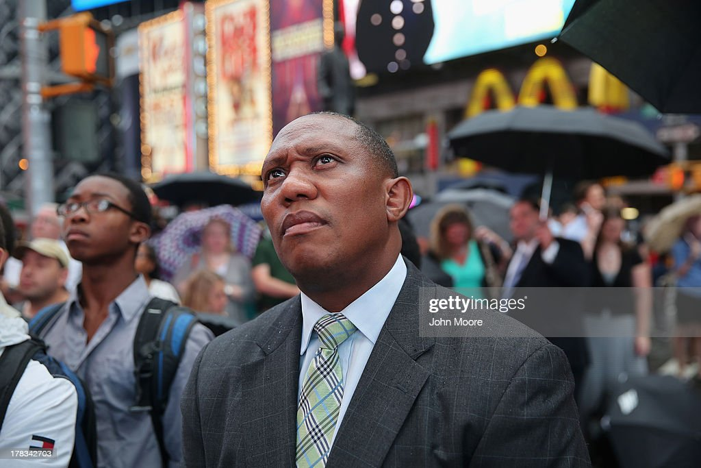 A crowd in Times Square listens as President Obama speaks on the 50th anniversary of Martin Luther King Jr.'s 'I Have a Dream' speech on August 28, 2013 in New York City. With the official ceremony in Washington D.C., a crowd gathered in Manhattan's Times Square to watch the President's speech broadcast live and commemorate the anniversary of one of the most important days in the history of American civil rights.