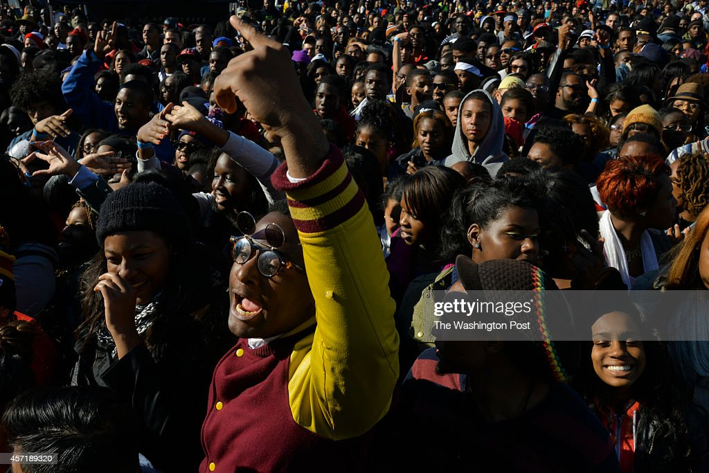 A crowd including Maxim Fields a 23yearold Howard University senior gathers to cheer on the musical performers at International Yardfest the...