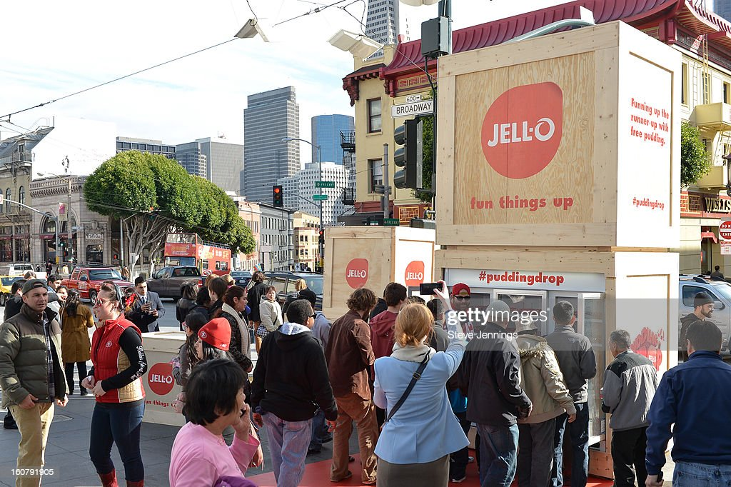 A crowd is served JELL-O pudding at the JELL-O Make The Taste of Defeat Sweet on February 5, 2013 in San Francisco, California.