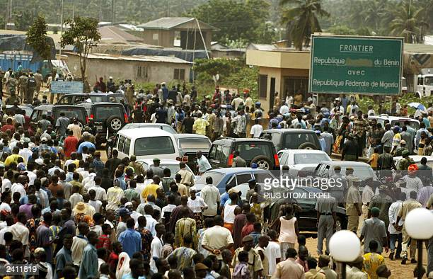 Crowd jubilates as Nigerian President Olusegun Obasanjo and his Beninese counterpart Matthew Kerekou leave the Seme border town in Badagry for the...