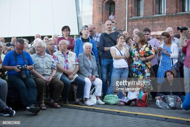 Crowd members listen as Martin Schulz chancellor candidate of the German Social Democrats is making a speech during an election campaign stop on...