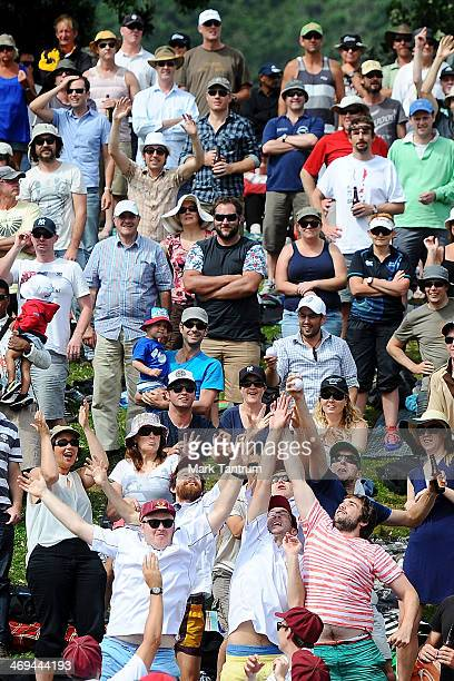 Crowd members reach up to catch a ball hit from the 1992 team during the 'One Year To Go' to the ICC Cricket World Cup announcement at the Basin...